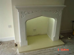 Fitting a plaster fireplace with honey creme marble hearth and downlighters